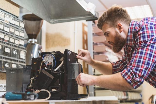 Service Pro for NetSuite - Technician Repairing Maintaining Coffee Machine